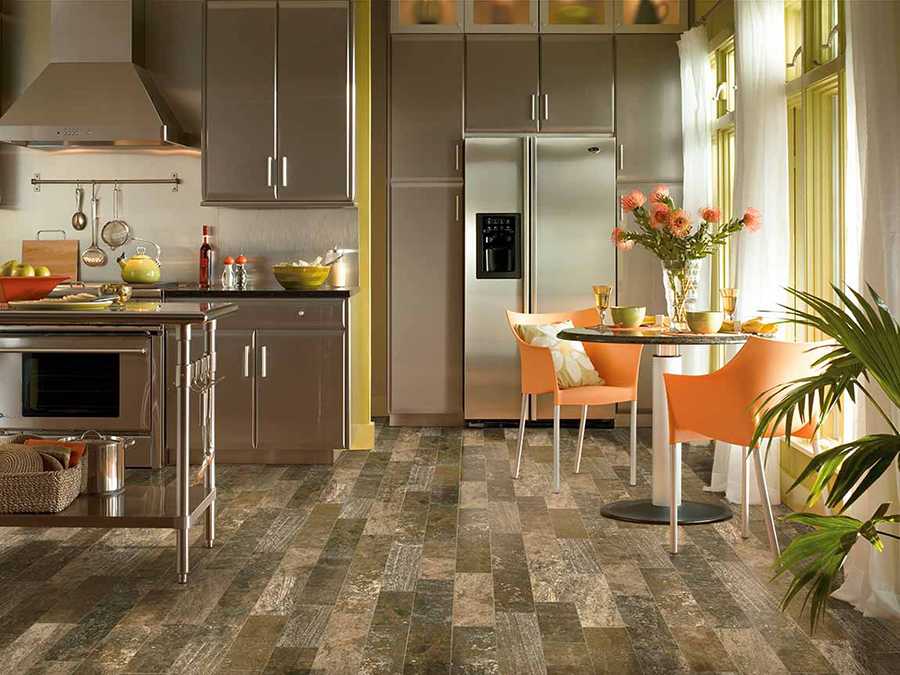 Eclectic styled kitchen that has porcelain tile wood-look flooring in varying colors